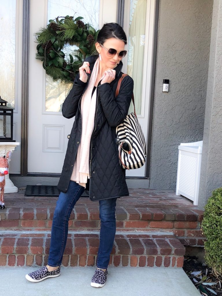 Standing in front of front door with large tote bag over shoulder